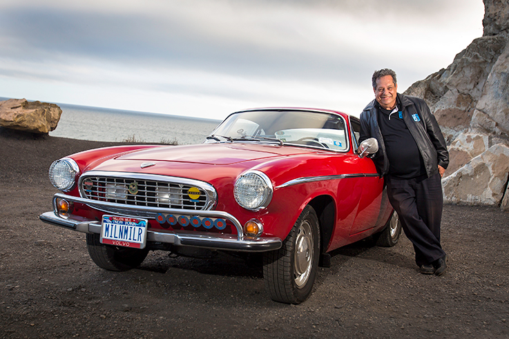 Irv Gordon and his cherry-red 1966 Volvo P1800S